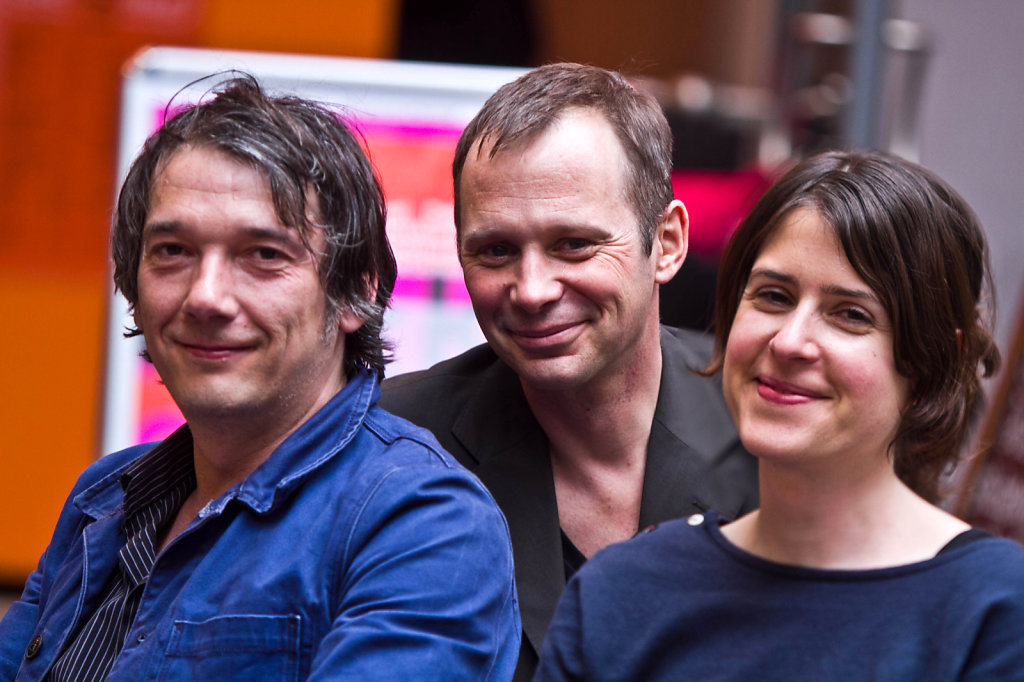 three people photographed in day light, portrait of jury at film festival dokka