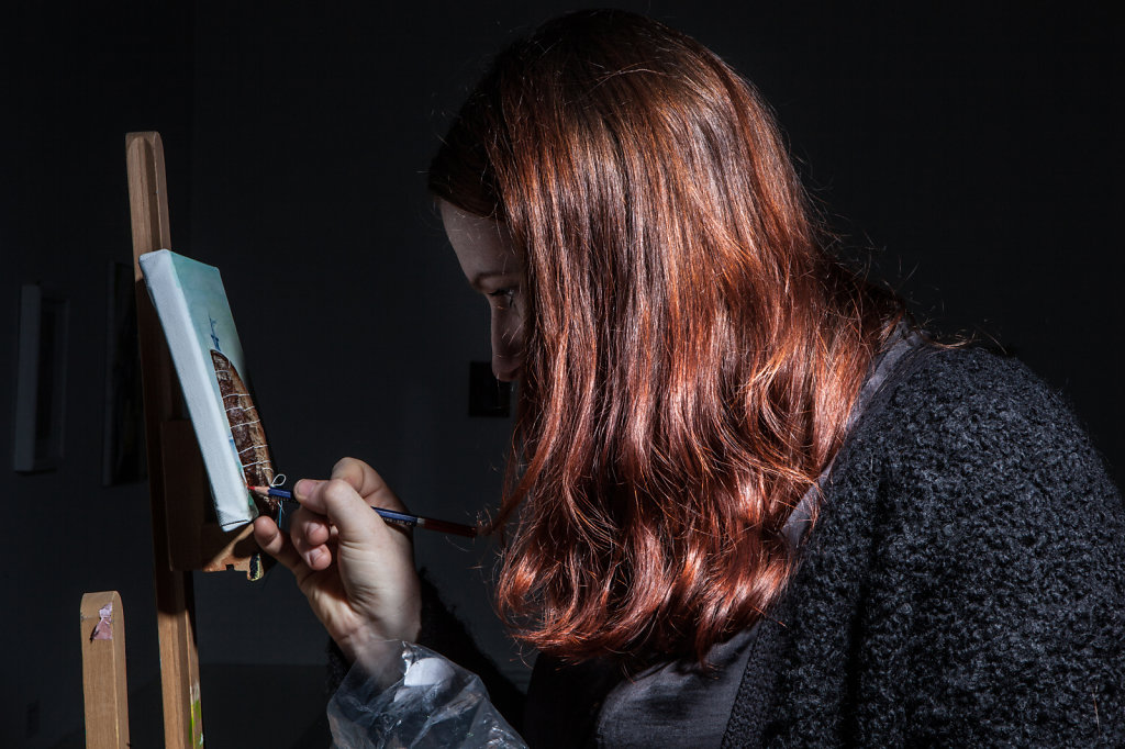 an artist making portraitraphed with studio flash