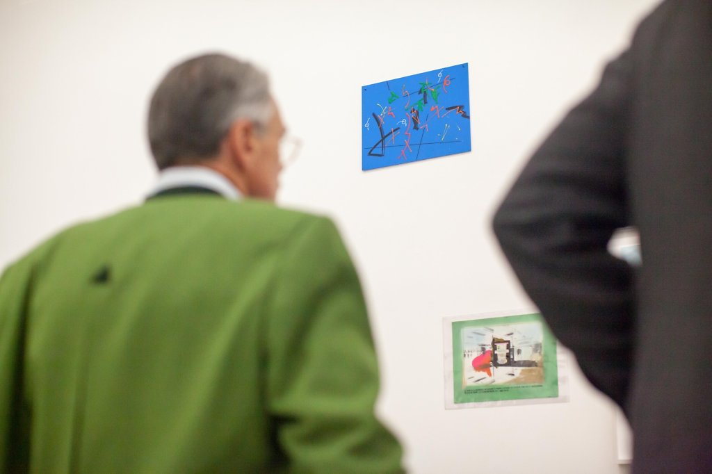 men looking at art in gallery space